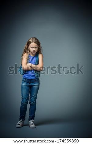 Sad girl in studio - stock photo