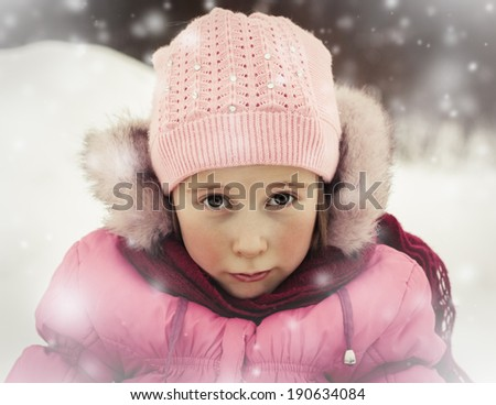 Sad girl in warm clothes outdoor in winter. - stock photo