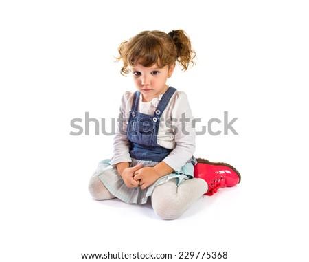 Sad girl over white background - stock photo