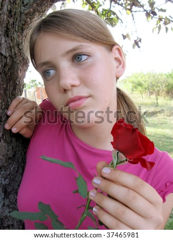 Sad girl with a red rose - stock photo