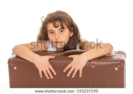 Sad girl with brown suitcase sitting on a white background - stock photo
