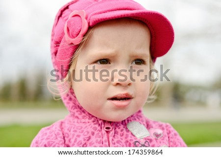 sad girl with  injury on her lip - stock photo