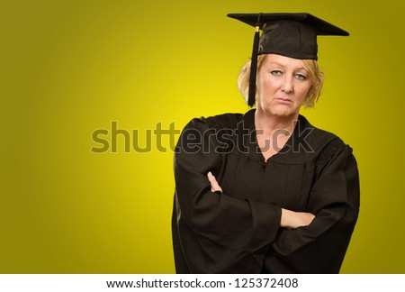 Sad Graduate Woman On Coloured Background - stock photo