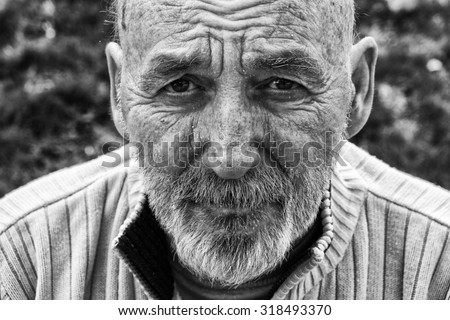 Sad homeless senior man - stock photo