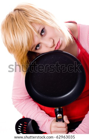 sad housewife with pan isolated on white background - stock photo