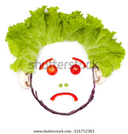 Sad human head made of vegetable pieces