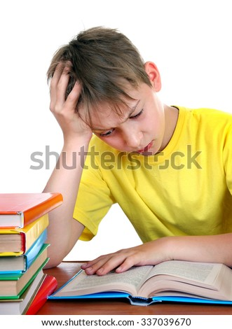Sad Kid at the School Desk with a Books Isolated on the White Background - stock photo
