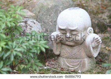 Sad kid statue, Japan - stock photo