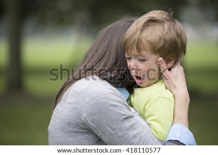 Sad little boy being hugged by his mother. Parenthood, Love and togetherness concept.