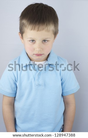 Sad little boy,isolated. - stock photo