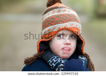 sad little boy pulling sad expression - stock photo
