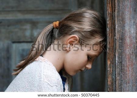 Sad little girl feels lonely. - stock photo