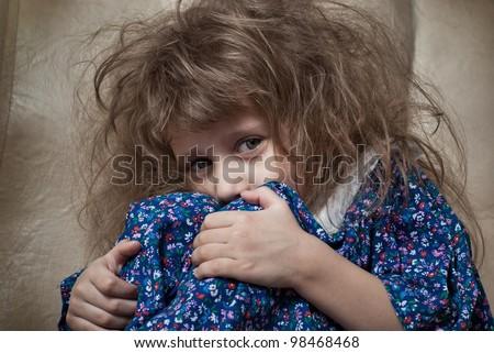 Sad little girl hides her face - stock photo