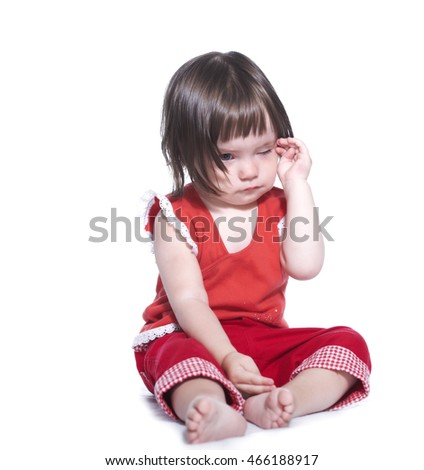 Sad little girl in a red suit. Isolated on white background