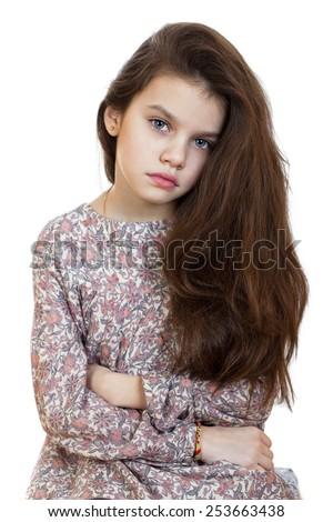 Sad little girl, isolated on white background - stock photo