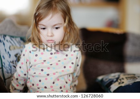 Sad little girl portrait - stock photo