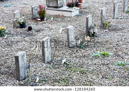 sad little graves of children died very young - stock photo