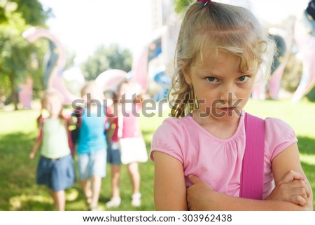 Sad lonely child being bullied by children - stock photo