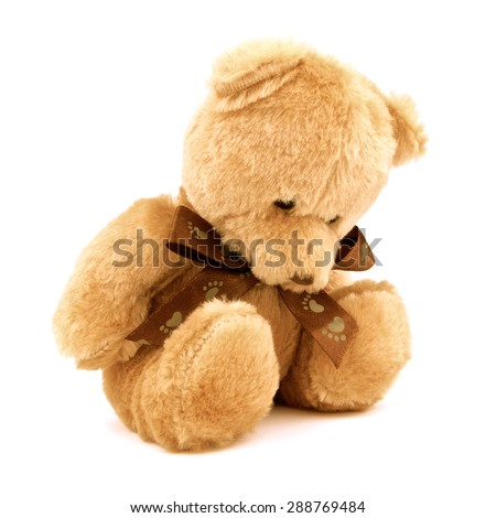 Sad lonely doll isolated on white background. Unhappy and alone doll. Close up. - stock photo