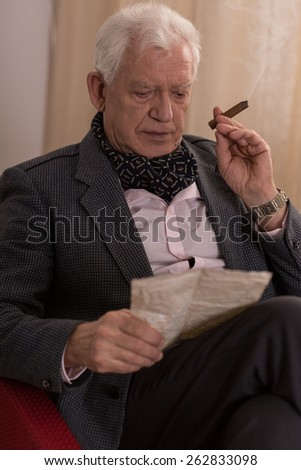 Sad lonely millionaire reading old letter from a lover - stock photo