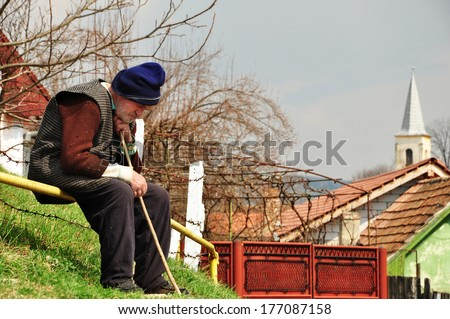 Sad lonely old man resting - stock photo