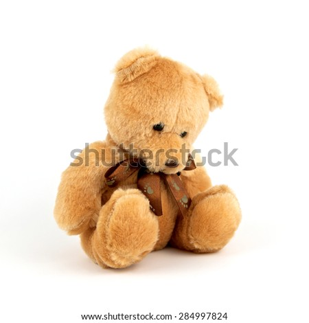 Sad lonely teddy bear isolated on white background. Unhappy and alone doll. Close up. - stock photo