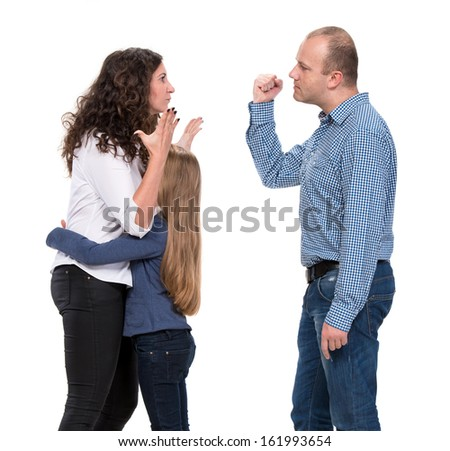 Sad looking girl with her fighting parents on a white background