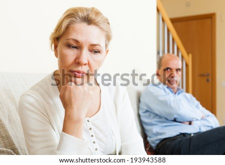 Sad  man and  woman during quarrel  in room at home    - stock photo