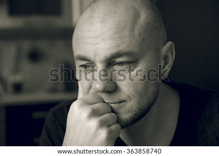 Sad man. Black and white photo - stock photo