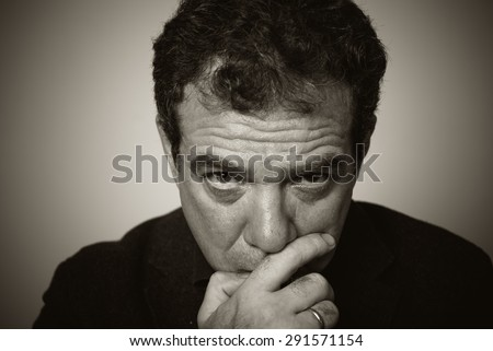 Sad man. Black and white portrait - stock photo