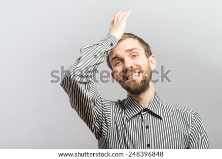 Sad man holding his forehead with his hand on white background - stock photo