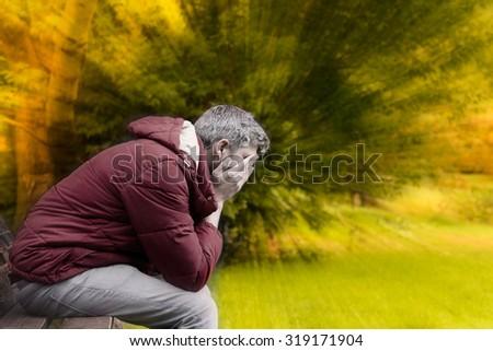sad man in autumn season crisis - stock photo
