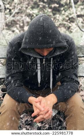 sad man sitting on bench - stock photo
