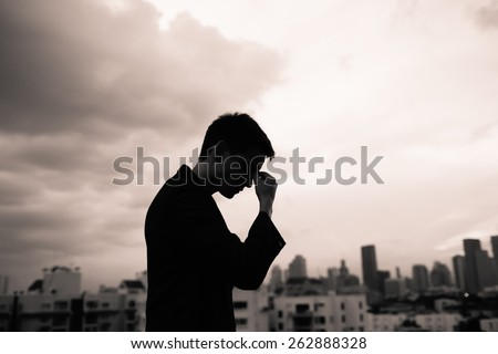 Sad man walking in the city - stock photo