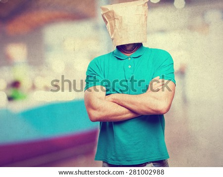 sad man with a paper bag in his head - stock photo