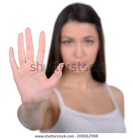 Sad ,mature , abused caucasian woman protect herself from violence. Isolated on white background - stock photo