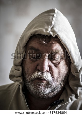 sad middle-aged bearded man