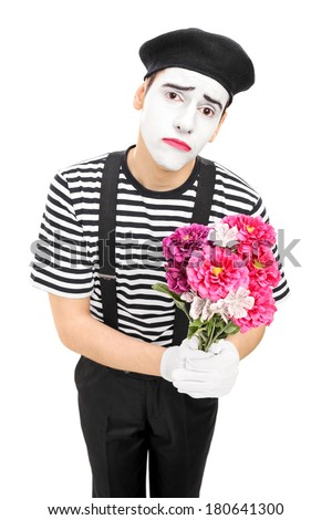 Sad mime artist holding a bouquet of flowers isolated on white background - stock photo