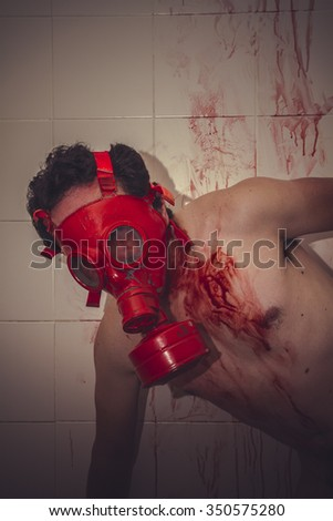 sad naked man with red gas mask, blood, despair and suicide - stock photo