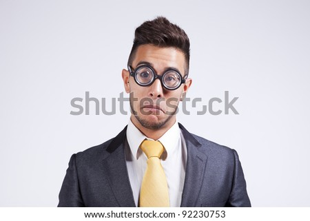 Sad nerd businessman with funny glasses - stock photo
