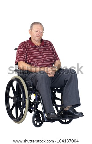 Sad or depressed senior man in a wheelchair, looking down, studio shot isolated over white background.