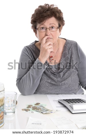 Sad pensioner woman have money problems - poverty in the age. - stock photo