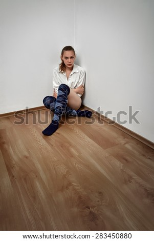 sad pensive woman sitting on floor