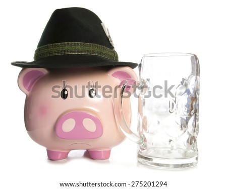 sad piggy bank wearing beer festival hat and empty pint cutout - stock photo