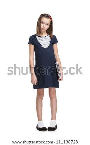 Sad schoolgirl carries her books, isolated, white background - stock photo