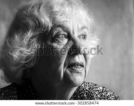 Sad senior caucasian woman
