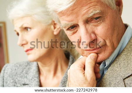 Sad senior couple - stock photo