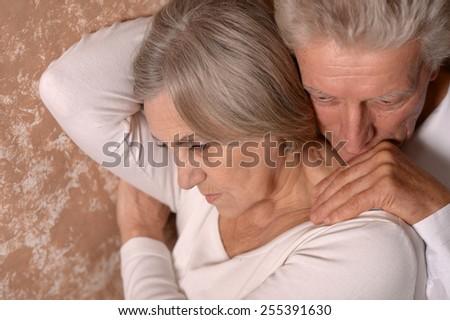 Sad Senior couple at home - stock photo