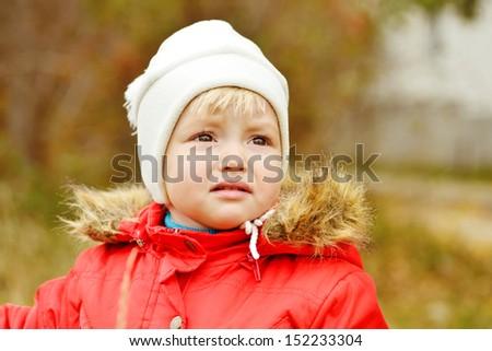 sad sweet baby girl outdoors - stock photo