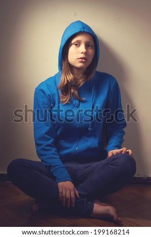 Sad teen girl in hood - stock photo